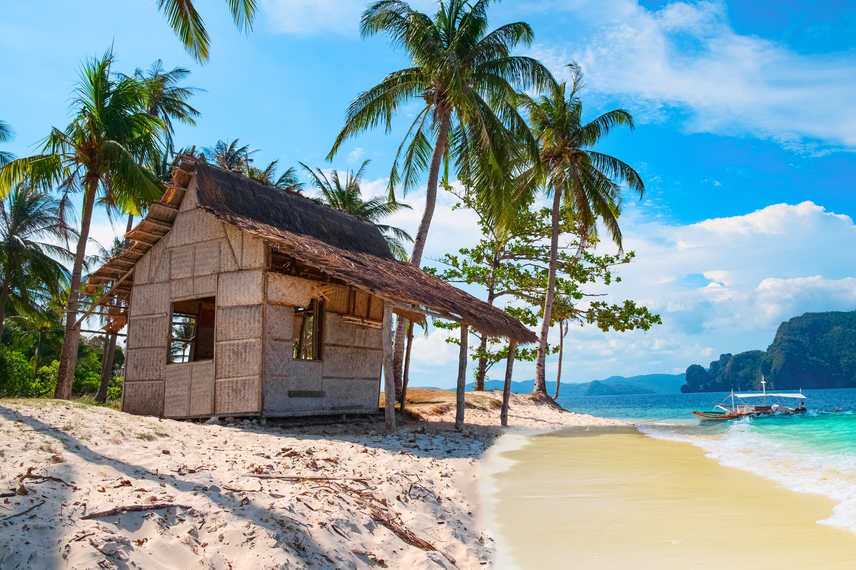Scenic tropical landscape, Palawan, Philippines, Southeast Asia. Beautiful tropical island with hut, sandy beach, palms. Sea bay scenery. Popular landmark, tourist destination of Philippines