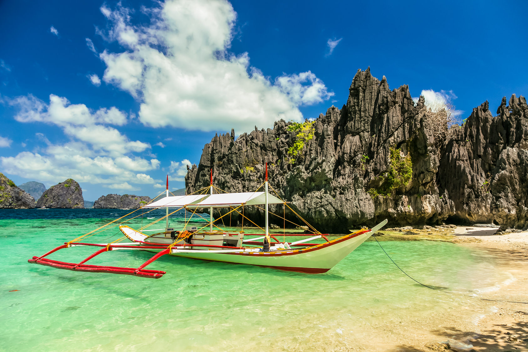 Banca boat at a beautiful beach in Miniloc Island,Philippines